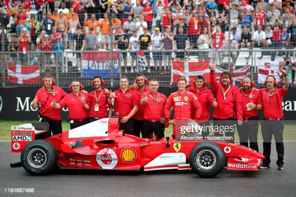 Mick Schumacher of Germany smiles after driving the Ferrari F2004 of his father Michael Schumacher before the F1 Grand Prix of Germany at...