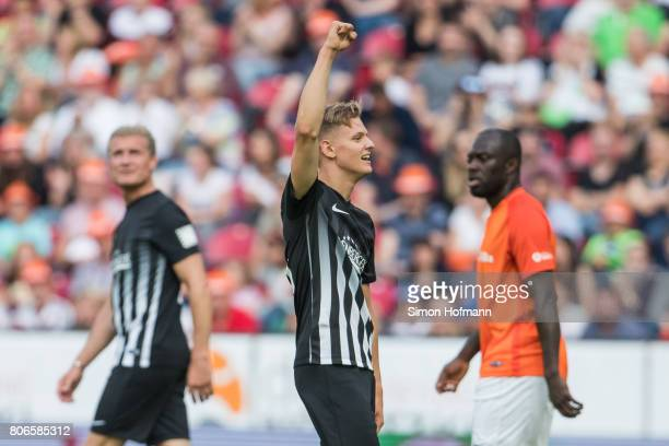 Mick Schumacher of Schumacher and Friends celebrates his team's second goal during the Champions for Charity Friendly match at Opel Arena on July 3...
