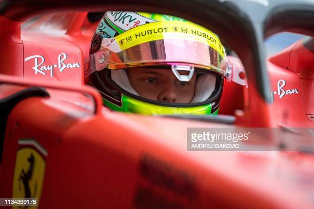 TOPSHOT Mick Schumacher returns to the garage after his first laps for Ferrari at the inseason test at the Sakhir circuit in the desert south of the...