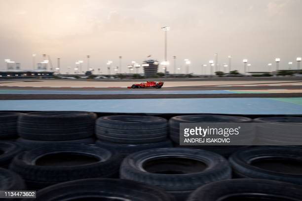 Mick Schumacher steers a Ferrari F1 car during private tests at the Sakhir circuit in the desert south of the Bahraini capital Manama, on April 2,...