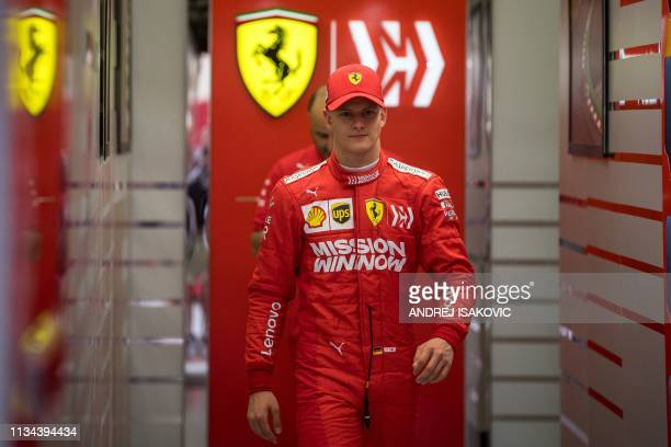 TOPSHOT Mick Schumacher walks out of the garage after his first laps for Ferrari at the inseason test at the Sakhir circuit in the desert south of...
