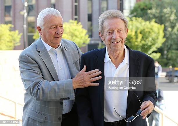 Mick Summerbee and Dennis Law arrive during day three of the Soccerex Global Convention at Manchester Central on September 7 2015 in Manchester...