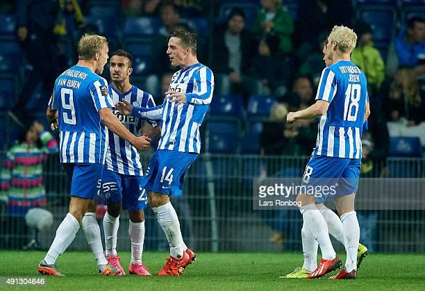 Mick van Buren of Esbjerg fB celebrates with Nicki Bille Nielsen after scoring their first goal during the Danish Alka Superliga match between...
