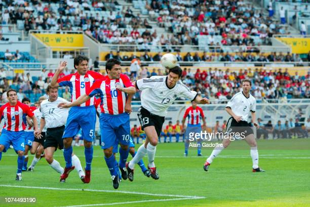 Mickael BALLACK and Roberto ACUNA during the FIFA World Cup match between Germany and Paraguay on June 15, 2002 in Jeju Stadium, South Korea.