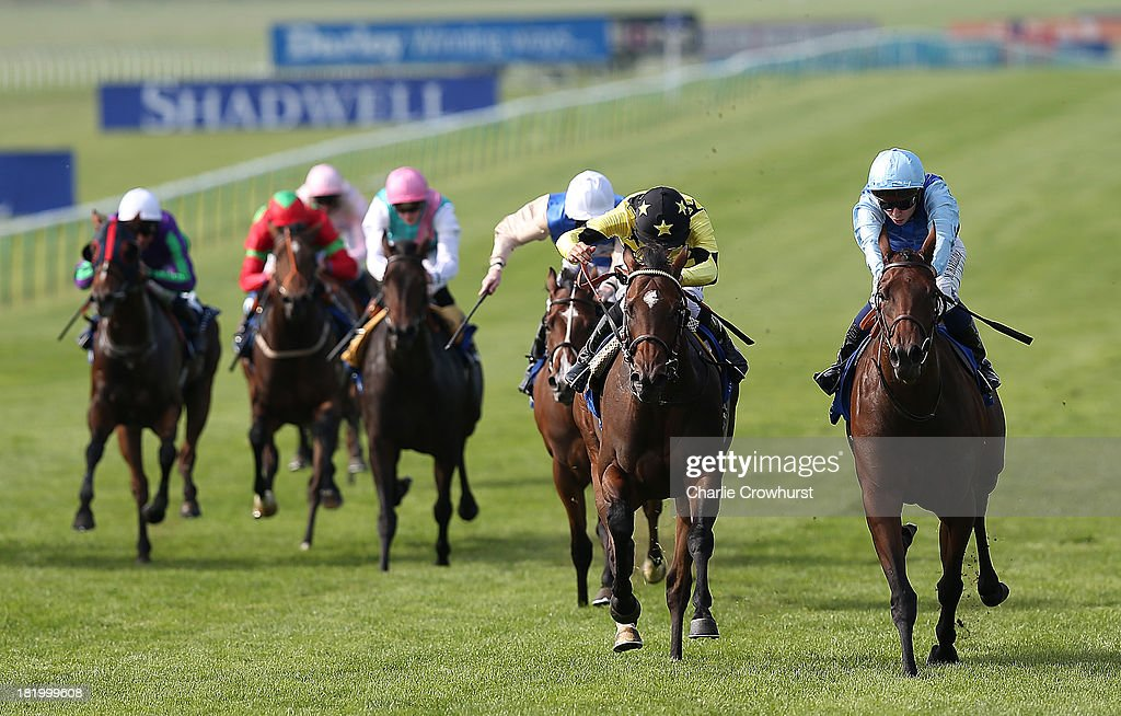 Mickael Barzalona on Miss France (R) beats Harry Bentley on Lighting Thunder (L) to win The Aqlaam Oh So Sharp Stakes at Newmarket racecourse on September 27, 2013 in Newmarket, England.