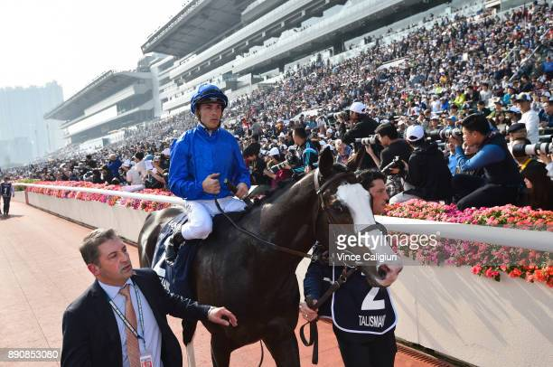 Mickael Barzalona riding Talismanic after finishing runner up in Race 4 The Longines Hong Kong Vase during Longines Hong Kong International Race Day...