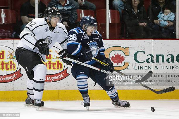Mickael Beauregard of the Gatineau Olympiques battles for the puck against Jeremy Bouchard of the Chicoutimi Sagueneens on February 20, 2015 at...