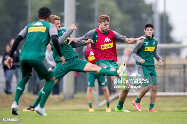 Mickael Cuisance and Christoph Kramer battle for the ball during a training session of Borussia Moenchengladbach at BorussiaPark on July 02 2017 in...