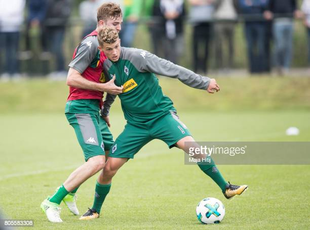 Mickael Cuisance and Christoph Kramer of Moenchengladbach ballte for the ball during Training Session on July 2 2017 in Moenchengladbach Germany