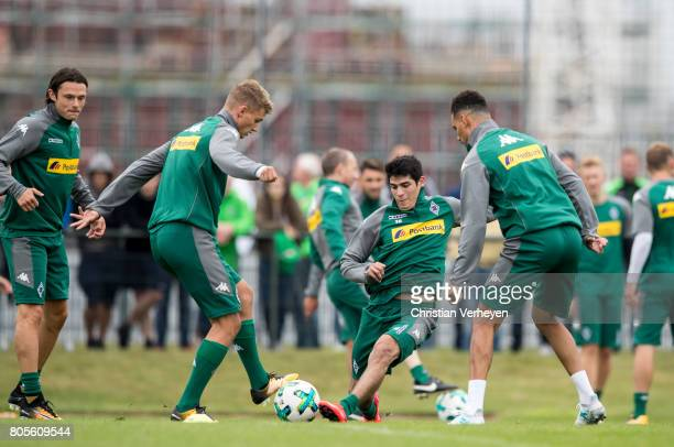 Mickael Cuisance and Julio Villalba battle for the ball during a training session of Borussia Moenchengladbach at BorussiaPark on July 02 2017 in...