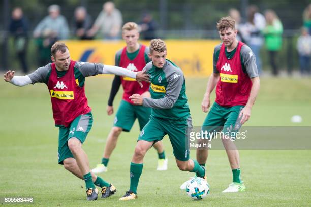 Mickael Cuisance and Tony Jantschke of Moenchengladbach ballte for the ball during Training Session on July 2 2017 in Moenchengladbach Germany