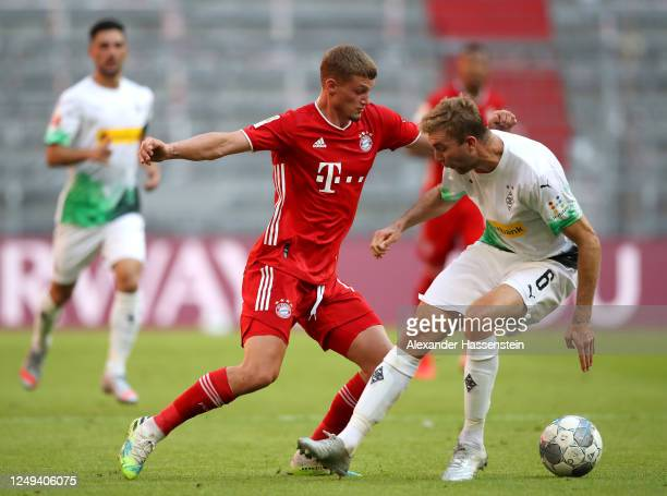 Mickael Cuisance of Bayern Munich is challenged by Christoph Kramer of Borussia Monchengladbach during the Bundesliga match between FC Bayern...