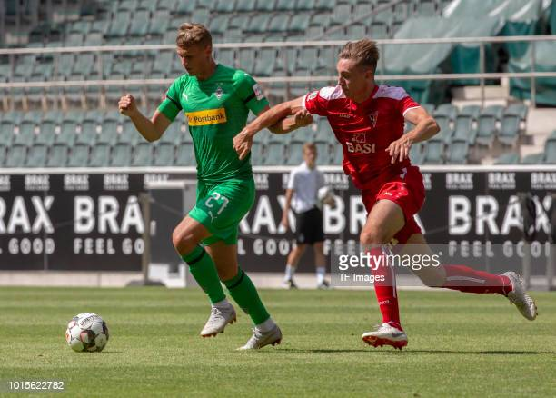 Mickael Cuisance of Borussia Moenchengladbach and Sebastian Wilms of WegbergBeeck battle for the ball during the friendly match between Borussia...