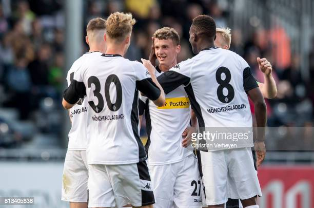 Mickael Cuisance of Borussia Moenchengladbach celebrate with his team mates after he scores his teams secon goal during the friendly match between...