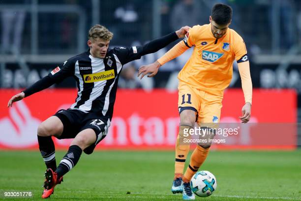 Mickael Cuisance of Borussia Monchengladbach Florian Grillitsch of Hoffenheim during the German Bundesliga match between Borussia Monchengladbach v...