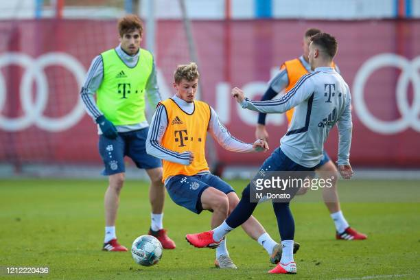 Mickael Cuisance of FC Bayern Muenchen and Lucas Hernandez of FC Bayern Muenchen fight for the ball during a training session at Saebener Strasse...