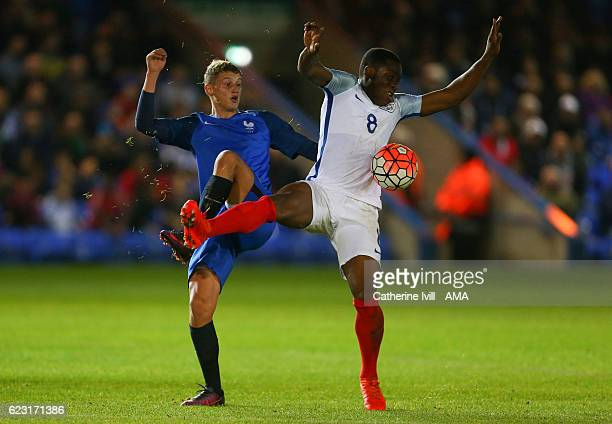 Mickael Cuisance of France U18 and Dennis Adeniran of England U18 during the U18 International Friendly match between England and France at London...
