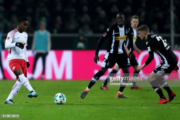 Mickael Cuisance of Mönchengladbach challenges Ademola Lookman of Leipzig during the Bundesliga match between Borussia Moenchengladbach and RB...