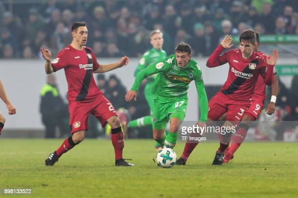 Mickael Cuisance of Moenchengladbach and Dominik Kohr of Leverkusen battle for the ball during the DFB Cup match between Borussia Moenchengladbach...