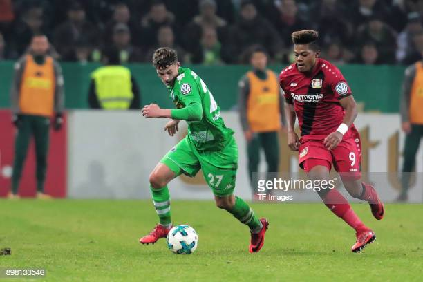 Mickael Cuisance of Moenchengladbach and Leon Bailey of Leverkusen battle for the ball during the DFB Cup match between Borussia Moenchengladbach and...