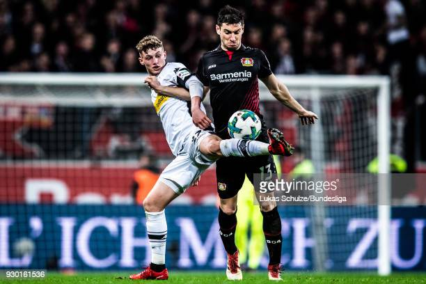 Mickael Cuisance of Moenchengladbach and Lucas Alario of Leverkusen in action during the Bundesliga match between Bayer 04 Leverkusen and Borussia...