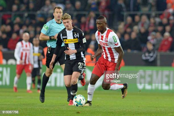 Mickael Cuisance of Moenchengladbach and Sehrou Guirassy of Koeln battle for the ball during the Bundesliga match between 1 FC Koeln and Borussia...
