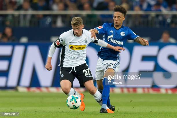 Mickael Cuisance of Moenchengladbach and Thilo Kehrer of Schalke battle for the ball during the Bundesliga match between FC Schalke 04 and Borussia...