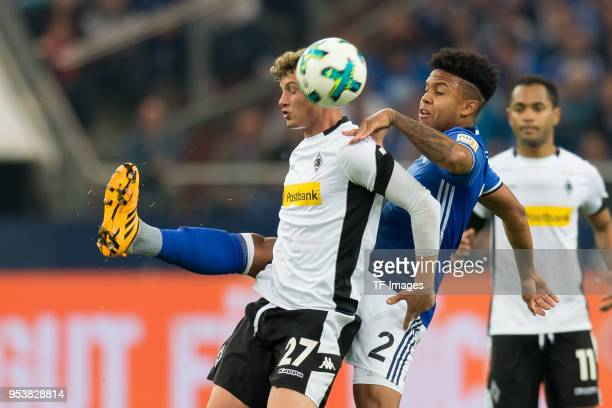 Mickael Cuisance of Moenchengladbach and Weston McKennie of Schalke battle for the ball during the Bundesliga match between FC Schalke 04 and...