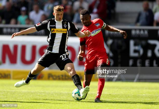 Mickael Cuisance of Moenchengladbach challenges Salomon Kalou of Berlin during the Bundesliga match between Borussia Moenchengladbach and Hertha BSC...