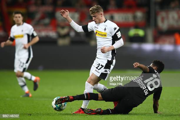 Mickael Cuisance of Moenchengladbach fights for the ball with Wendell of Bayer Leverkusen during the Bundesliga match between Bayer 04 Leverkusen and...