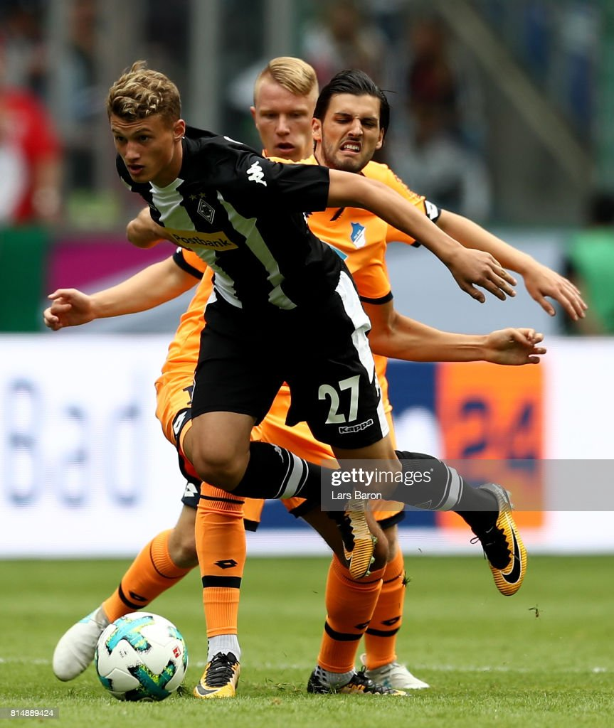 Mickael Cuisance of Moenchengladbach is challenged by Florian Grilllitsch during the Telekom Cup 2017 3rd place match between Borussia Moenchengladbach and TSG Hoffenheim at Borussia Park on July 15, 2017 in Moenchengladbach, Germany.