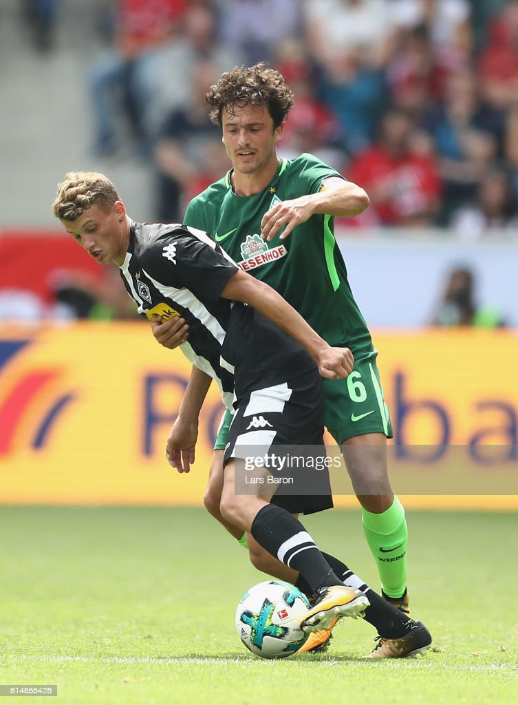 Mickael Cuisance of Moenchengladbach is challenged by Thomas Delaney of Bremen during the Telekom Cup 2017 match between Borussia Moenchengladbach and Werder Bremen at on July 15, 2017 in Moenchengladbach, Germany.