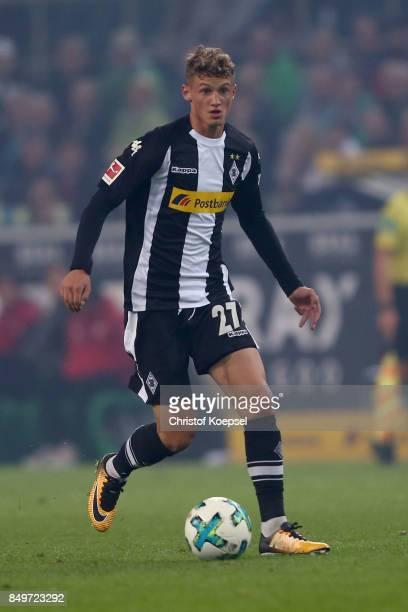Mickael Cuisance of Moenchengladbach runs with the ball during the Bundesliga match between Borussia Moenchengladbach and VfB Stuttgart at...