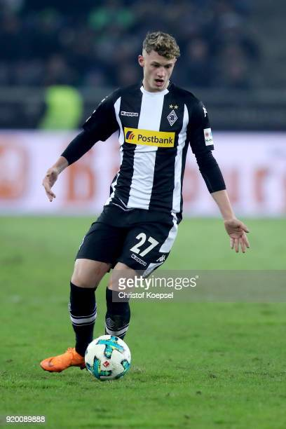 Mickael Cuisance of Moenchengladbach runs with the ball during the Bundesliga match between Borussia Moenchengladbach and Borussia Dortmund at...