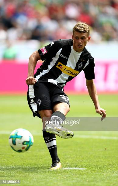 Mickael Cuisance of Moenchengladbach shoots on goal during the Telekom Cup 2017 match between Borussia Moenchengladbach and Werder Bremen at on July...