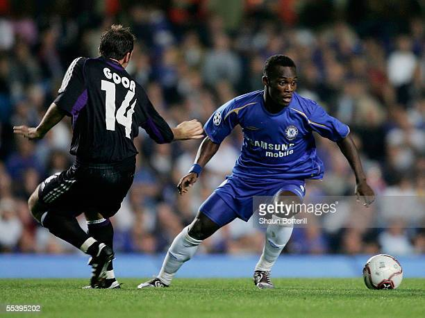 Mickael Essien of Chelsea evades Bart Goor of Anderlechtduring the UEFA Champions League match between Chelsea and RSC Anderlecht at Stamford Bridge...