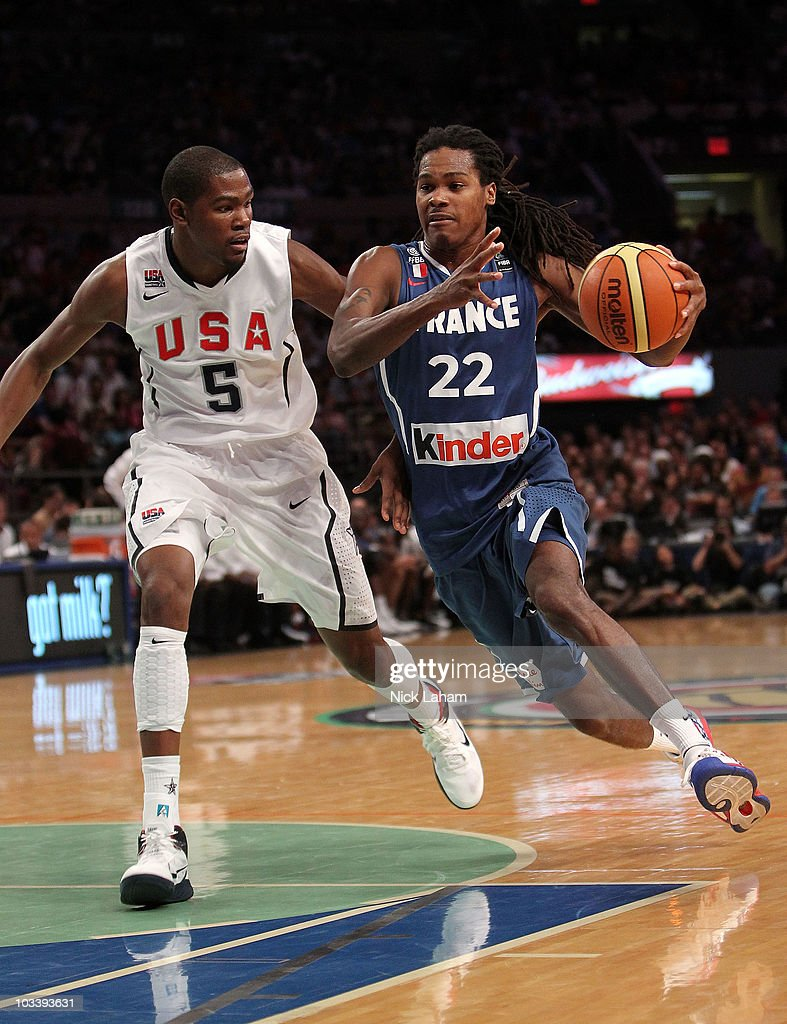 Mickael Gelabale #22 of France drives to the basket past Kevin Durant #5 of the United States during their exhibition game as part of the World Basketball Festival at Madison Square Garden on August 15, 2010 in New York City.