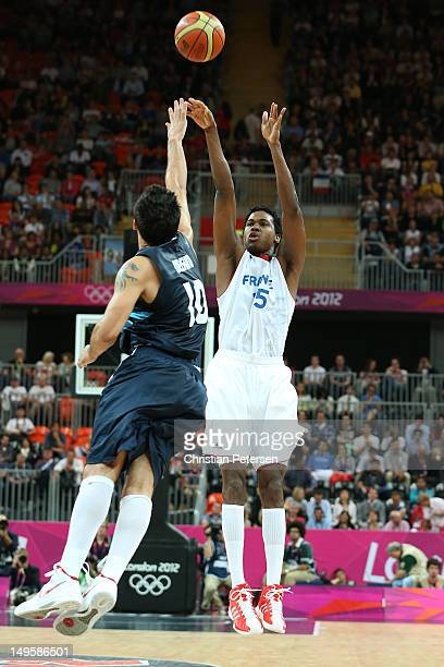 Mickael Gelabale of France takes a jump shot in the Men's Basketball Preliminary Round match between France and Argentina on Day 4 of the London 2012...