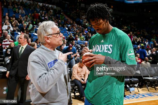 Mickael Gelabale of the Minnesota Timberwolves signs an autograph before playing against the New Orleans Hornets on March 17 2013 at Target Center in...