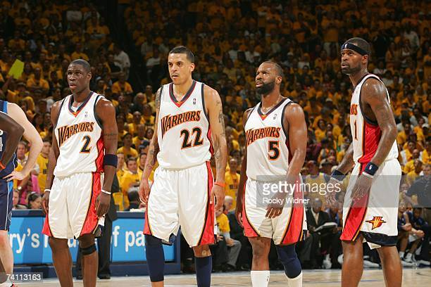Mickael Pietrus, Matt Barnes, Baron Davis and Stephen Jackson of the Golden State Warriors walk upcourt in Game Six of the Western Conference...