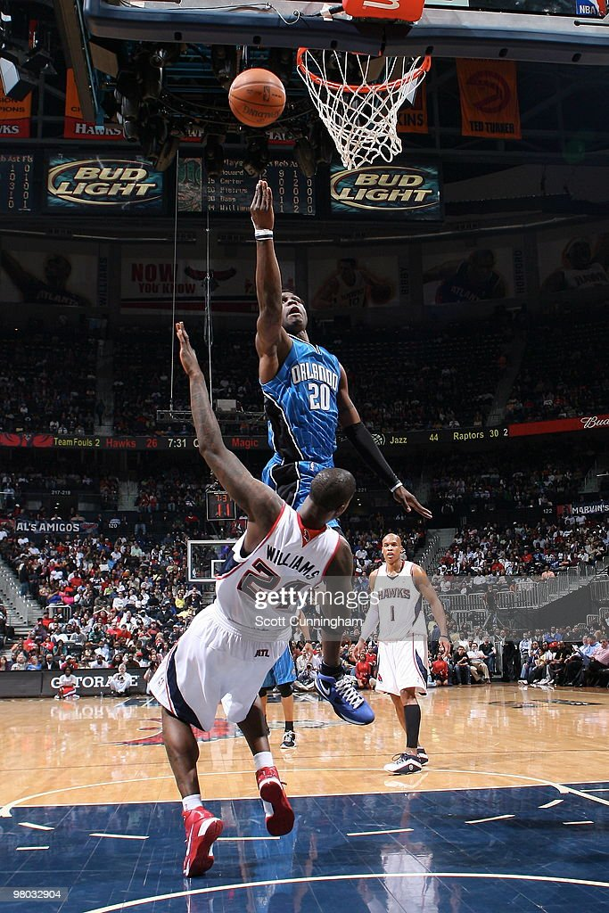 Mickael Pietrus #20 of the Orlando Magic puts up a shot against Marvin Williams #24 of the Atlanta Hawks on March 24, 2010 at Philips Arena in Atlanta, Georgia.