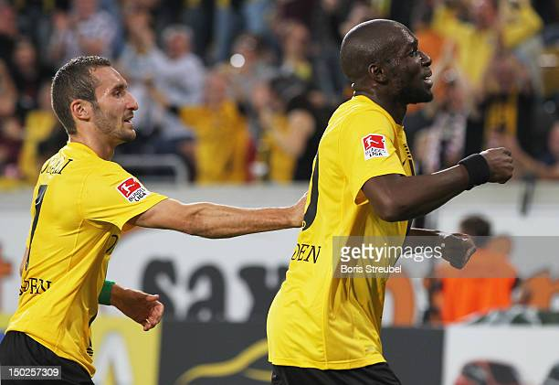 Mickael Pote of Dresden celebrates his team's first goal with his team mate Idir Ouali during the Second Bundesliga match between SG Dynamo Dresden...