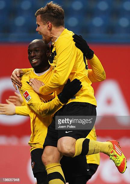 Mickael Pote of Dresden celebrates with his team mate Florian Jungwirth after scoring his team's second goal during the Second Bundesliga match...