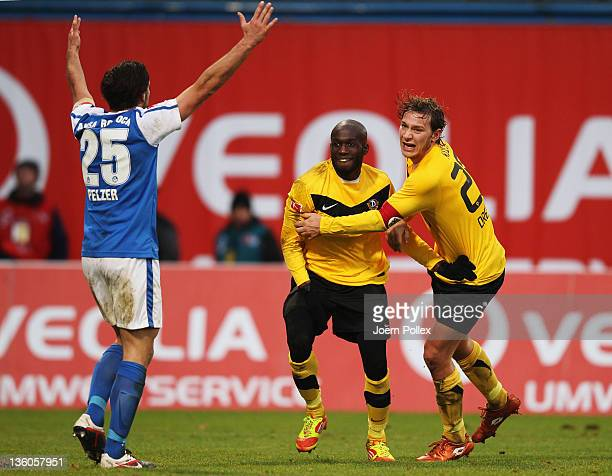Mickael Pote of Dresden celebrates with his team mate Robert Koch after scoring his team's second goal during the Second Bundesliga match between FC...