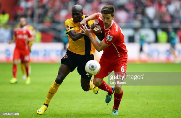 Mickael Pote of Dresden is challenged by Dustin Bomheuer of Duesseldorf during the Second Bundesliga match between Fortuna Duesseldorf and Dynamo...