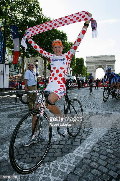 Mickael Rasmussen of Denmark and Rabobank poses in the polkadot jersey with a matching scarf during the team parade after Stage 21 of the 92nd Tour...