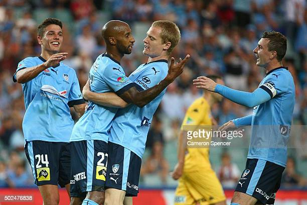 Mickael Tavares of Sydney FC celebrates kicking a penalty goal with team mate Matt Simon during the round 12 A-League match between Sydney FC and the...