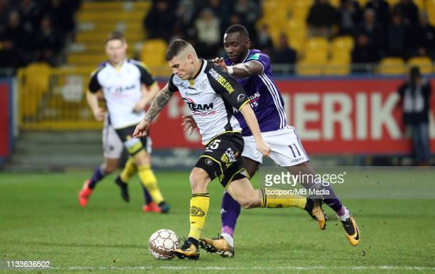 Mickael Tirpan of Lokeren and Yannick Bolasie of Anderlecht fight for the ball during the Jupiler Pro League match between KSC Lokeren OV and RSC...