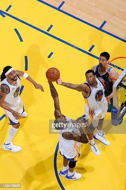 Mickell Gladness and Jeremy Tyler of the Golden State Warriors collaborate on a rebound in a game against the New Orleans Hornets on April 24, 2012...