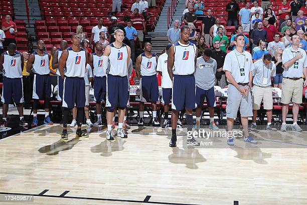 Mickell Gladness, Brian Butch, Assistant Coach Casey Hill and the D-League Select team players line up during the NBA Summer League game between the...